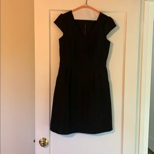 Black fit and flare dress with cap sleeves. 4
